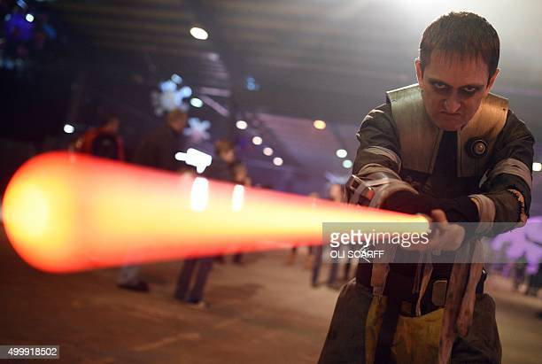 A performer dressed as the Star Wars character Galen Marek brandishes a lightsaber during the unofficial Star Wars convention 'For the Love of the...