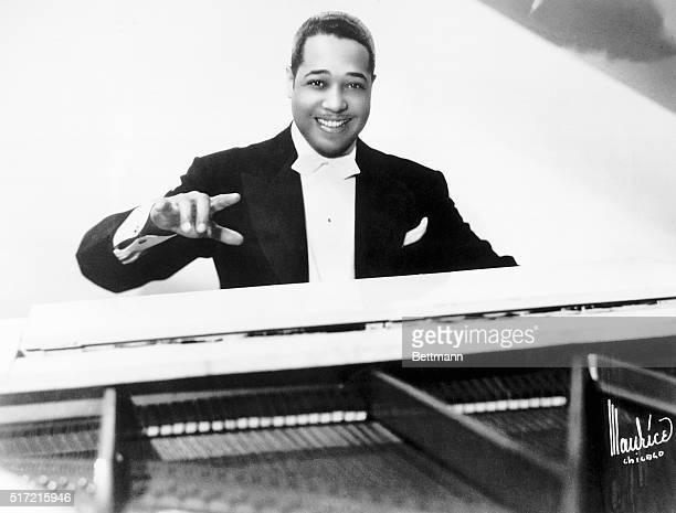Performer Duke Ellington seated at a piano wearing a tuxedo