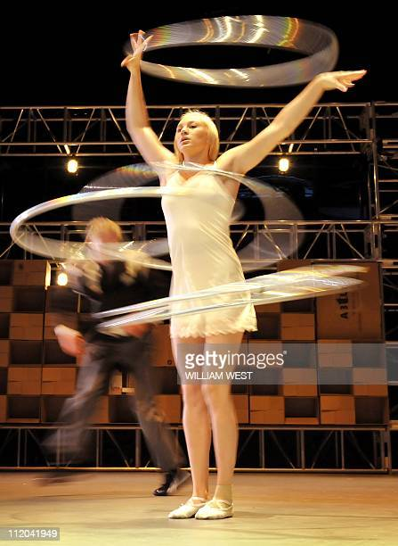 Performer Emma Shepherd operates the hulahoops during a performance by the National Institute of Circus Arts final year students in collaboration...