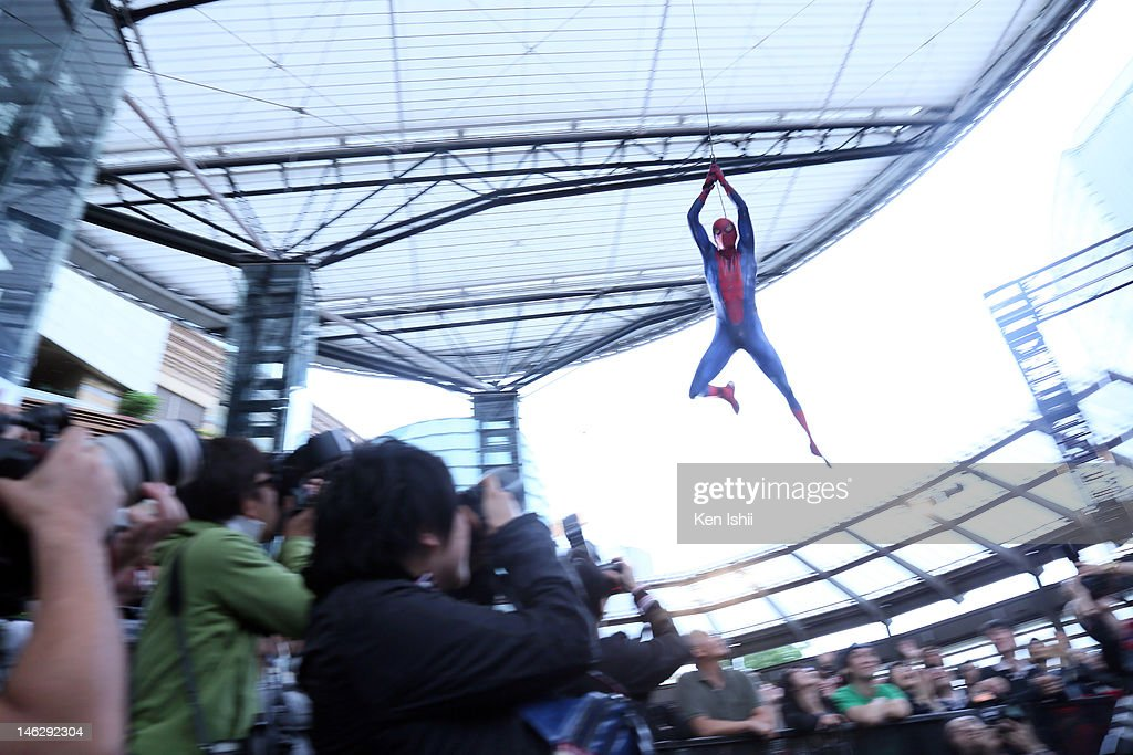 A performer flies over the media during the world Premiere of 'The Amazing Spider-Man' at Roppongi Hills on June 13, 2012 in Tokyo, Japan. The film will open on June 30 in Japan.