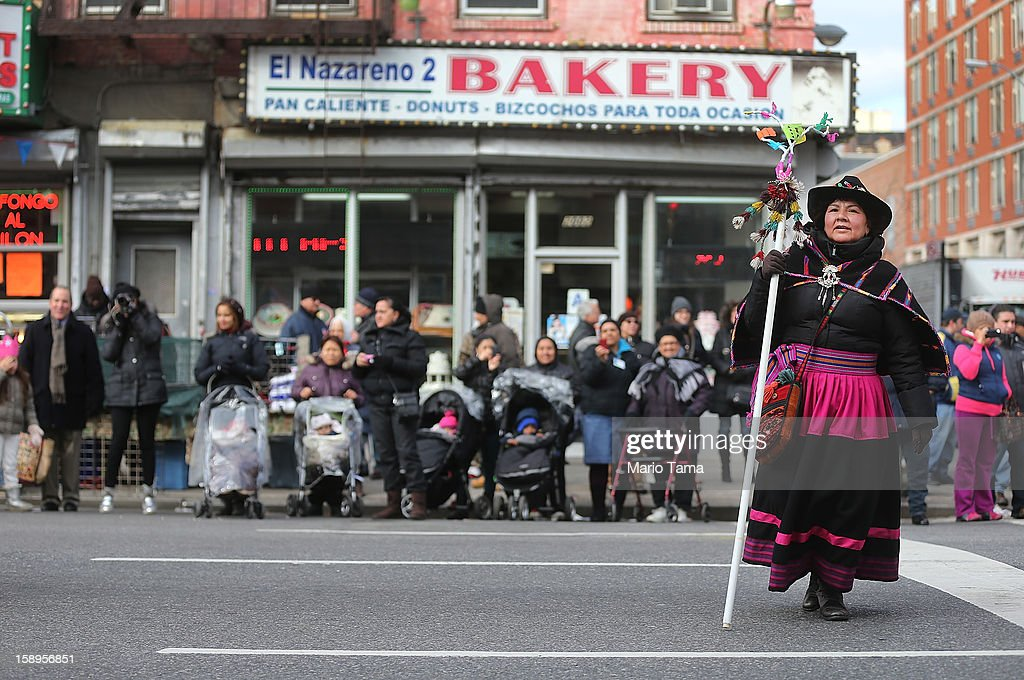 A performer from Abya Yala Art and Culture marches during the Three Kings Day Parade in East Harlem on January 4, 2013 in New York City. The parade celebrates the Feast of the Epiphany, also known as Three Kings Day, marking the Biblical story of the visit of three kings to Bethlehem to visit the baby Jesus, revealing his divinity.
