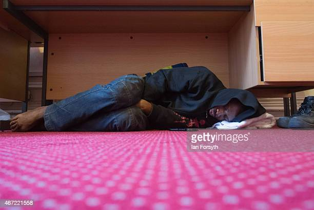 A performer from the Circus of Horrors catches up on sleep ahead of an evening performance at the Town Hall on March 20 2015 in Middlesbrough England...