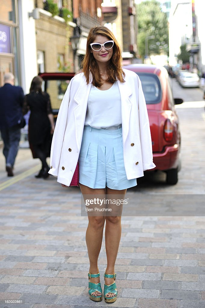 Performer Gemma (26) poses wearing Chloe top, Gucci jacket, Michael Kors shoes and a Stella Mccartney bag at the Holly Fulton catwalk show during London Fashion Week S/S 2013 on September 15, 2012 in London, England.