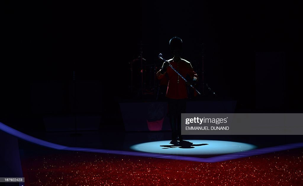 A performer gets ready during the 2013 Victoria's Secret Fashion Show at the Lexington Avenue Armory on November 13, 2013 in New York. AFP PHOTO/Emmanuel Dunand
