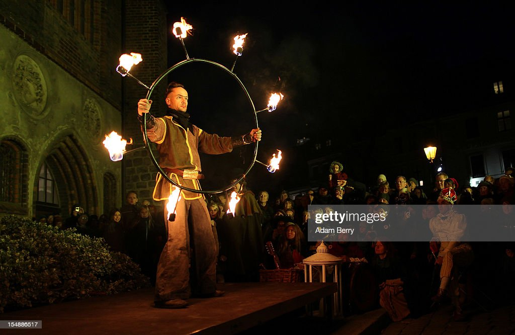 A performer gives a medieval-themed fire performance as part of celebrations marking the 775th anniversary of the city of Berlin on October 28, 2012 in Berlin, Germany. The settlement of Coelln, which stood opposite Berlin on the Spree river, is first referred to in a document from 1237, and by the beginning of the 14th century Coelln and Berlin joined together to become the region's most important trading center.