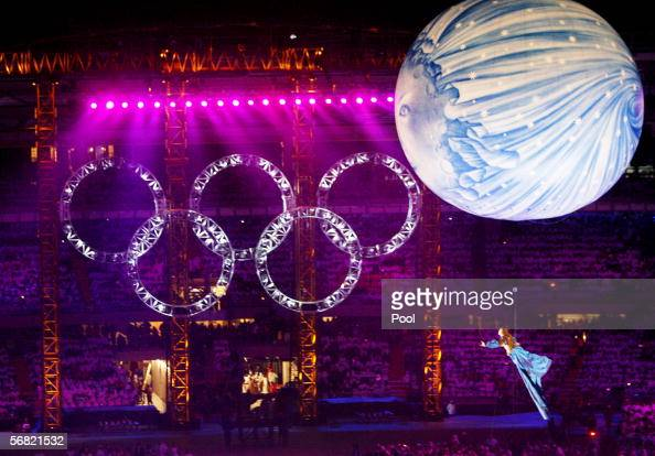 A performer glides past the Olympic rings during the Opening Ceremony of the Turin 2006 Winter Olympic Games on February 10 2006 at the Olympic...