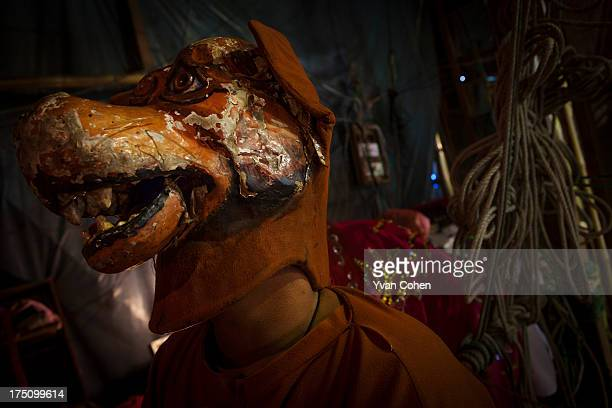 A performer in a dog costume back stage during a Chinese opera performance in Bangkok Chinese opera is performed in Thailand by itinerant groups of...