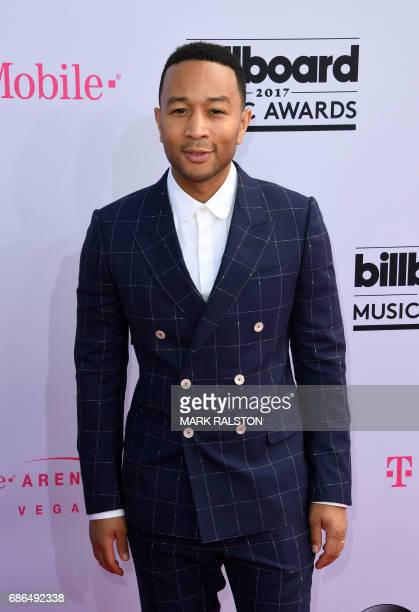 Performer John Legend arrives for the 2017 Billboard Music Awards at the TMobile Arena on May 21 2017 in Las Vegas Nevada / AFP PHOTO / MARK RALSTON