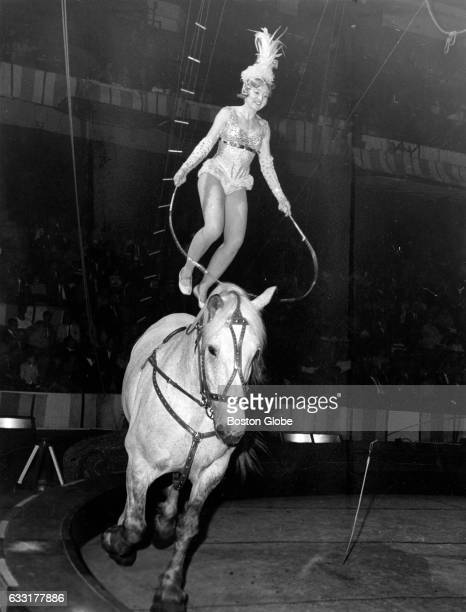 A performer jumps rope on a horse's back during the opening of the Ringling Bros and Barnum Bailey Circus at Boston Garden May 15