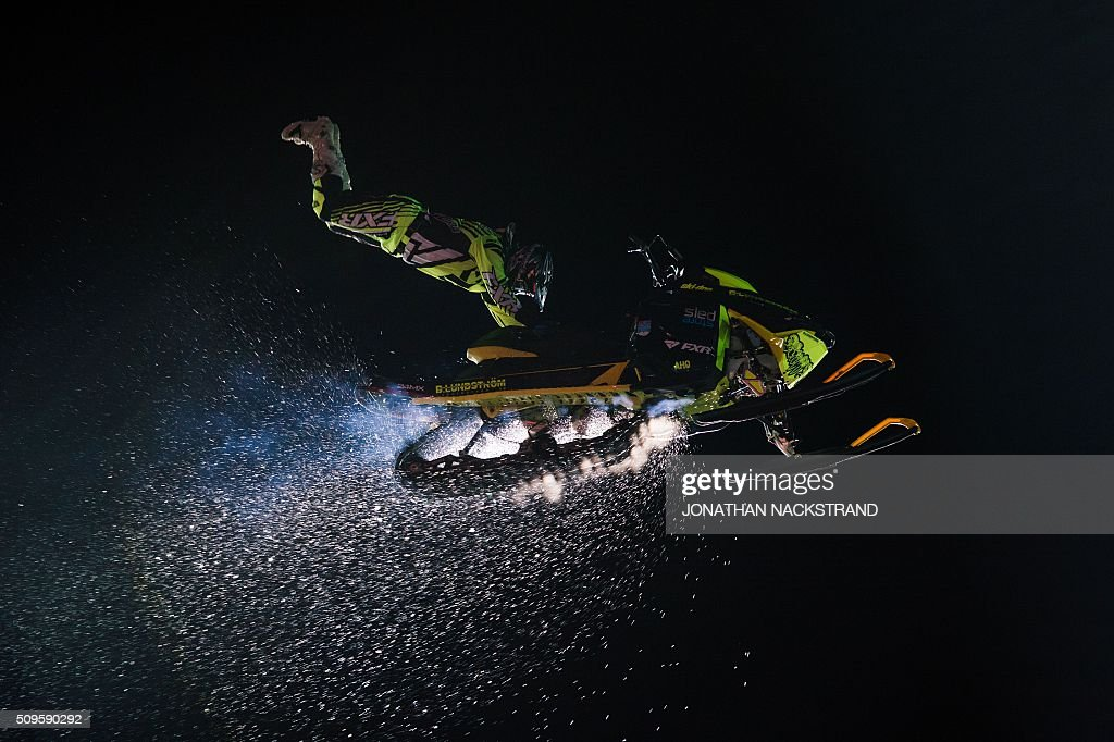TOPSHOT A performer jumps with his snow scooter ahead of the Rally Sweden second round of the FIA World Rally Championship on February 11 2016 in...