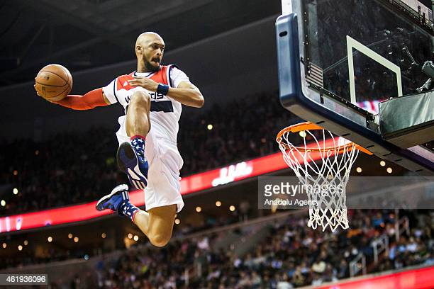 A performer launches off a trampoline for a dunk between the third and fourth quarter of the Oklahoma City Thunderand Washington Wizards NBA game at...