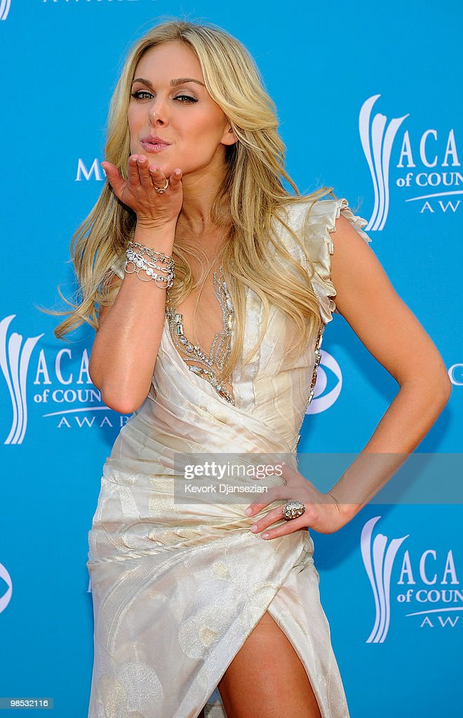 Performer <a gi-track='captionPersonalityLinkClicked' href=/galleries/search?phrase=Laura+Bell+Bundy&family=editorial&specificpeople=666348 ng-click='$event.stopPropagation()'>Laura Bell Bundy</a> arrives for the 45th Annual Academy of Country Music Awards at the MGM Grand Garden Arena on April 18, 2010 in Las Vegas, Nevada.