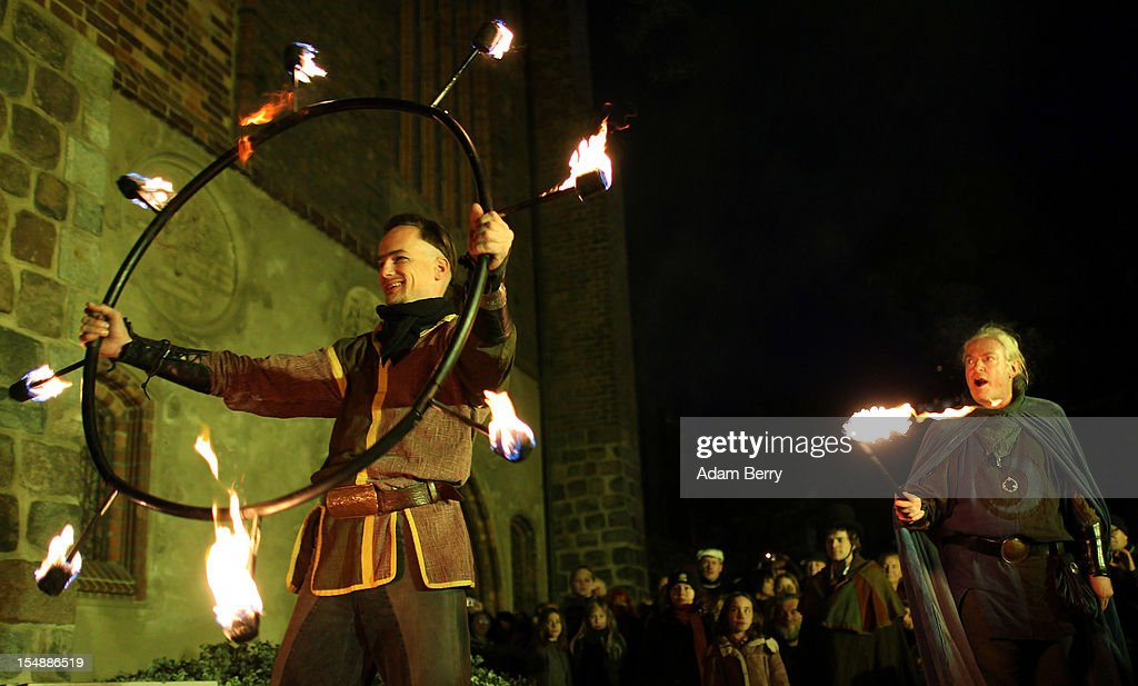 A performer leaves the stage after giving a medieval-themed fire performance as part of celebrations marking the 775th anniversary of the city of Berlin on October 28, 2012 in Berlin, Germany. The settlement of Coelln, which stood opposite Berlin on the Spree river, is first referred to in a document from 1237, and by the beginning of the 14th century Coelln and Berlin joined together to become the region's most important trading center.