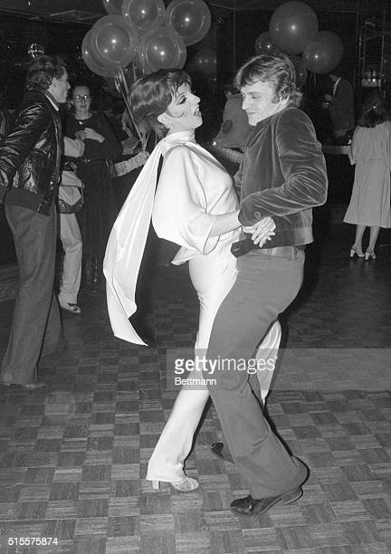 Performer Liza Minnelli and ballet dancer Mikhail Baryshnikov dance together at Studio 54 in Manhattan during a night on the town