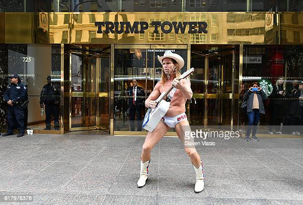 A performer 'Naked Cowboy' poses for a photo outside of Trump Tower on October 25 2016 in New York City
