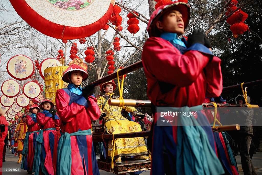 A performer (C) plays the role of the emperor during a re-enactment of an ancient ceremony of Qing Dynasty emperors praying for good harvest and fortune during the opening ceremony of the Spring Festival Temple Fair at the Temple of Earth park on February 9, 2013 in Beijing, China. The Chinese Lunar New Year of Snake also known as the Spring Festival, which is based on the Lunisolar Chinese calendar, is celebrated from the first day of the first month of the lunar year and ends with Lantern Festival on the Fifteenth day.