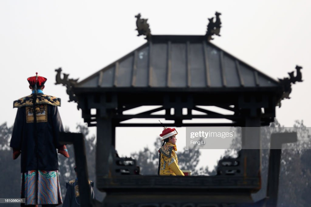 A performer (R) plays the role of the emperor during a re-enactment of an ancient ceremony of Qing Dynasty emperors praying for good harvest and fortune during the opening ceremony of the Spring Festival Temple Fair at the Temple of Earth park on February 9, 2013 in Beijing, China. The Chinese Lunar New Year of Snake also known as the Spring Festival, which is based on the Lunisolar Chinese calendar, is celebrated from the first day of the first month of the lunar year and ends with Lantern Festival on the Fifteenth day.