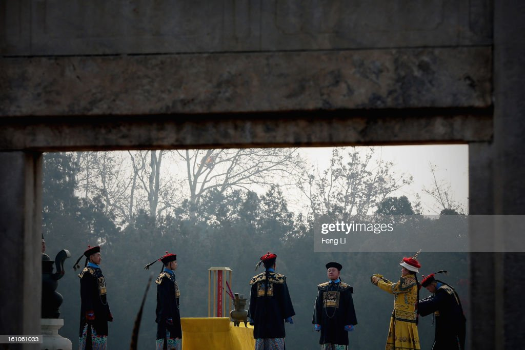 A performer (2nd R) plays the role of the emperor during a re-enactment of an ancient ceremony of Qing Dynasty emperors praying for good harvest and fortune during the opening ceremony of the Spring Festival Temple Fair at the Temple of Earth park on February 9, 2013 in Beijing, China. The Chinese Lunar New Year of Snake also known as the Spring Festival, which is based on the Lunisolar Chinese calendar, is celebrated from the first day of the first month of the lunar year and ends with Lantern Festival on the Fifteenth day.