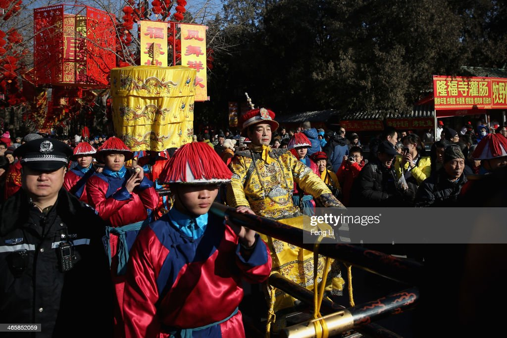 A performer (C) plays the role of the emperor during a re-enactment of an ancient ceremony of Qing Dynasty emperors praying for good harvest and fortune during the opening ceremony of the Spring Festival Temple Fair at the Temple of Earth park on January 30, 2014 in Beijing, China. The Chinese Lunar New Year of Horse also known as the Spring Festival, which is based on the Lunisolar Chinese calendar, is celebrated from the first day of the first month of the lunar year and ends with Lantern Festival on the Fifteenth day.