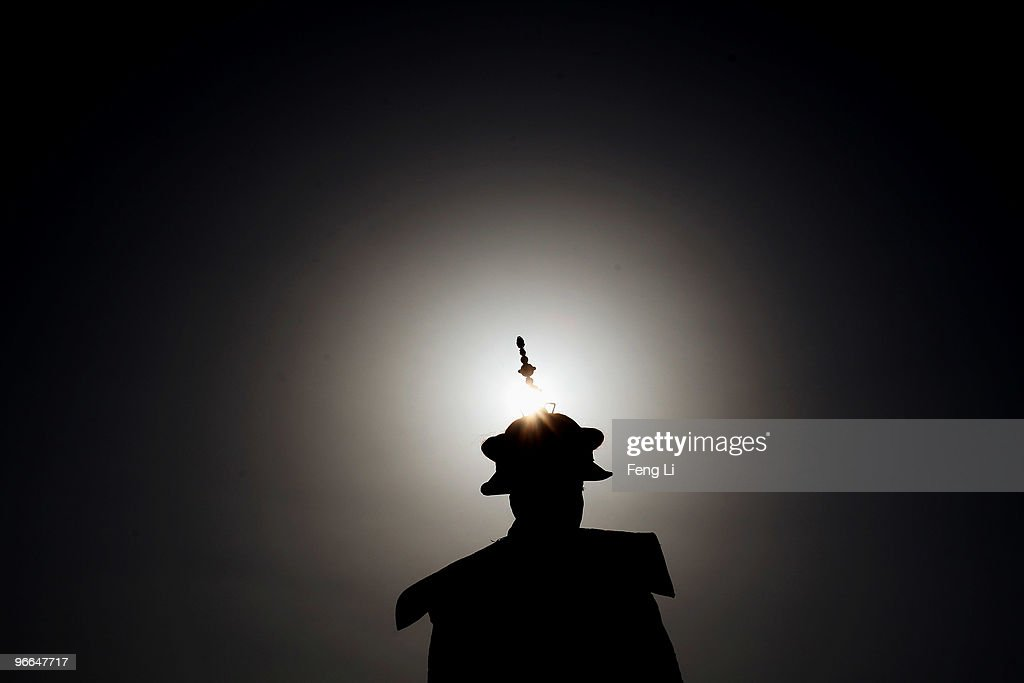 A performer plays the role of the emperor during a reenactment of an ancient ceremony of Qing Dynasty emperors praying for good harvest and fortune...