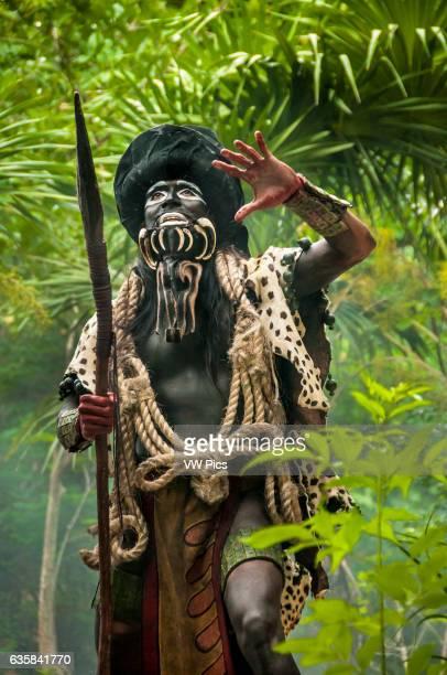Performer portraying the Maya god 'Ek chuah' or God of Cacao during the show 'Los Rostros de Ek chuah' at Xcaret ecoarcheological park Riviera Maya...