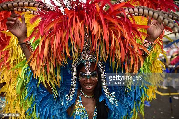 A performer poses for a photograph on the second day of the Notting Hill Carnival in west London on August 31 2015 Nearly one million people are...