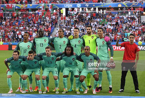A performer poses next Cristiano Ronaldo of Portugal during the team photograph before the UEFA EURO 2016 semi final match between Portugal and Wales...