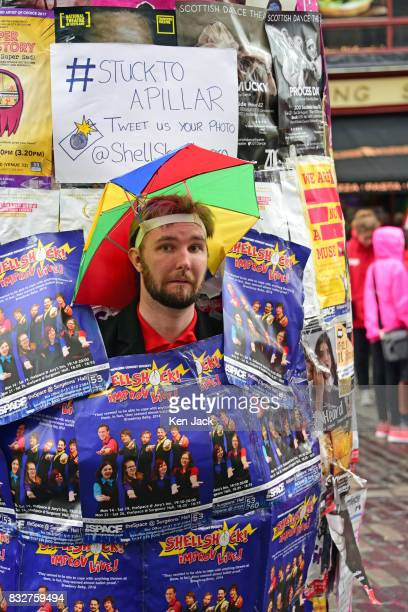 A performer poses on the Royal Mile during the Edinburgh Festival Fringe on August 16 2017 in Edinburgh Scotland The Fringe is celebrating its 70th...
