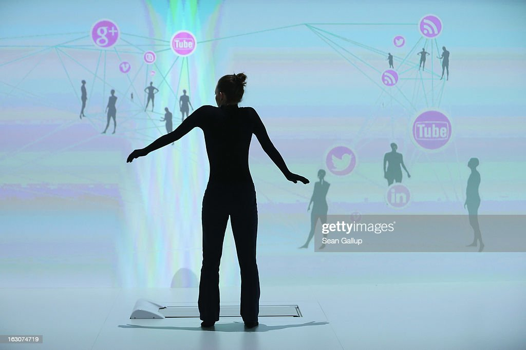 A performer practices her steps at the IBM stand at the 2013 CeBIT technology trade fair the day before the fair opens to visitors on March 4, 2013 in Hanover, Germany. CeBIT will be open March 5-9.