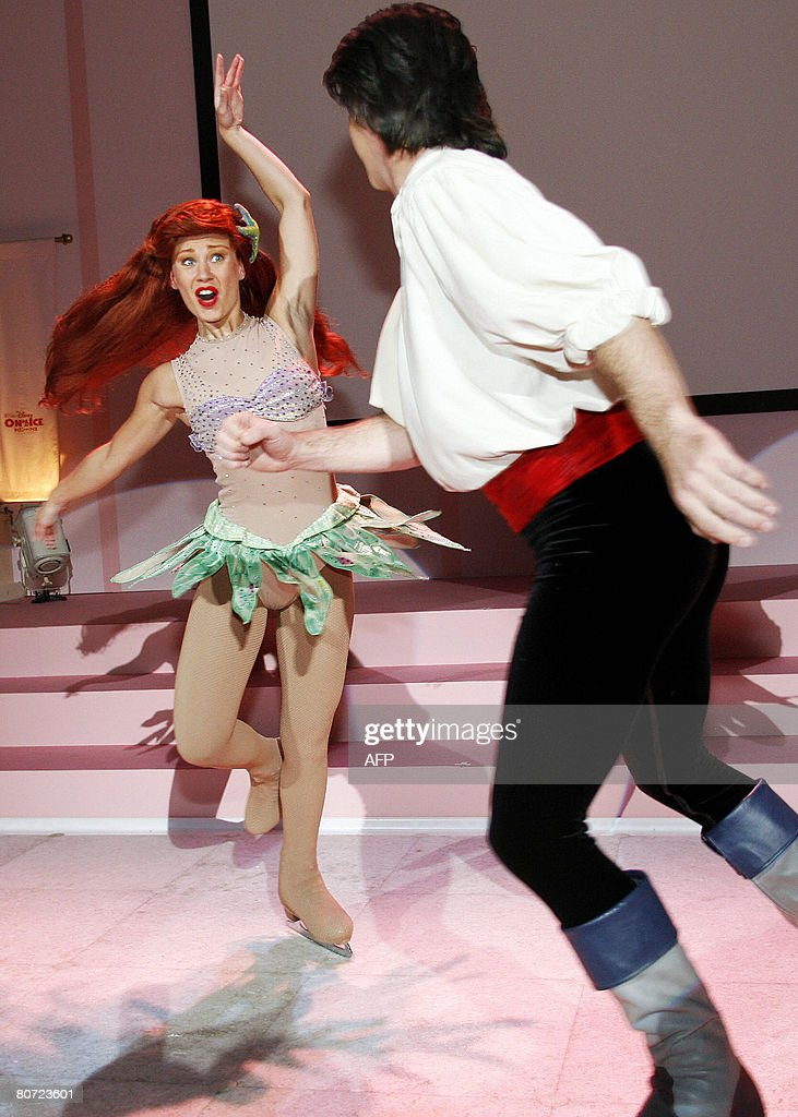 A performer representing Disney's mermaid character Ariel and a 'prince' skate on a special ice rink as Disney annouces the opening of the 2008...