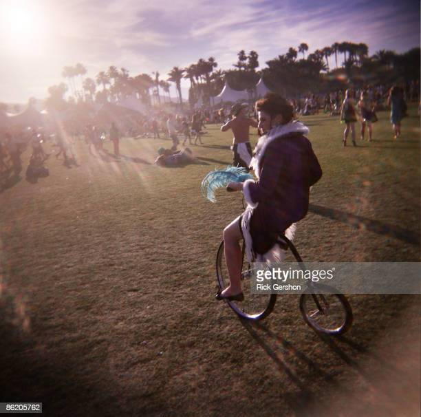 A performer rides a bicycle through the festival grounds at the Coachella Valley Music and Arts Festival at the Empire Polo Fields on April 19 2009...