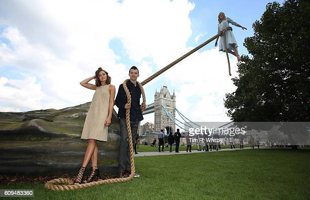 Performer Sally Miller standing in for the character played by Ella Purnell with actor Asa Butterfield during a photocall for Tim Burton's 'Miss...