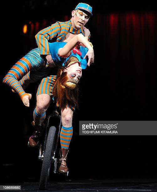 Performer show their unicycle duo stage during the 'Kooza' press preview in Tokyo on February 1 2011 Cirque Du Soleil will start their threemonthlong...
