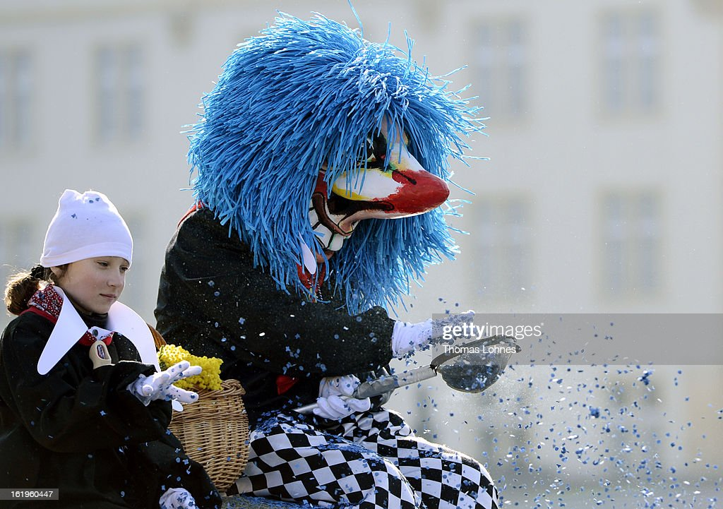A performer with a typical mask takes part in the Basel Fasnacht Carnival on February 18, 2013 in Basel, Switzerland. More than 12,000 participants will take part in the largest carnival in Switzerland that lasts for 72 hours and will be watched by more than 100,000 spectators as it makes its way through the city center.
