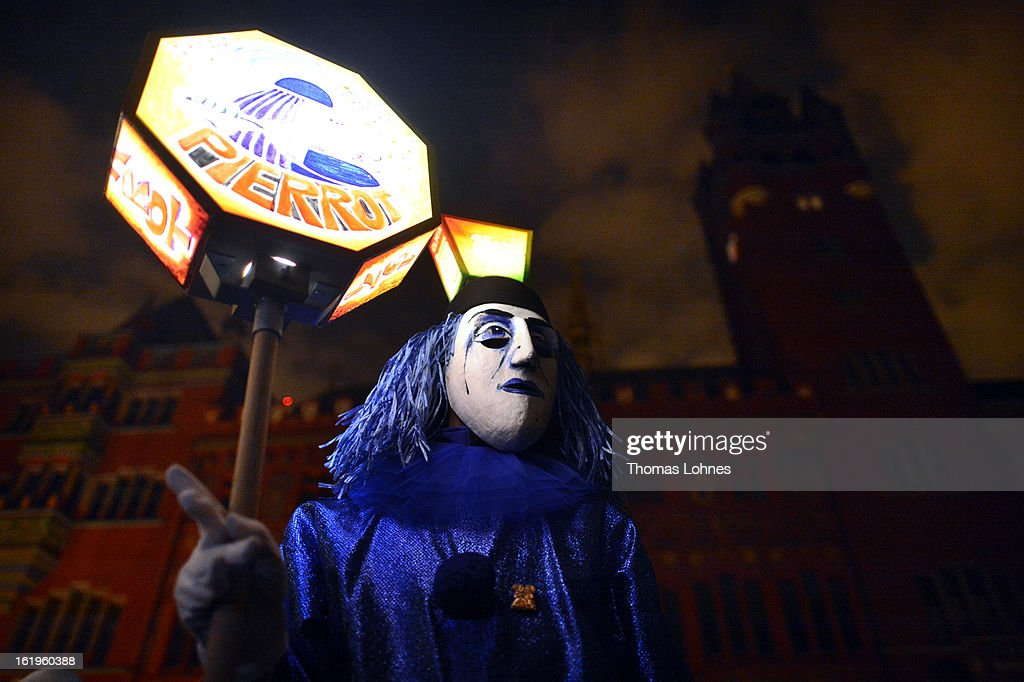 A performer with a typical mask takes part in the traditional 'Morgestraich' for the opening of the Basel Fasnacht Carnival on February 18, 2013 in Basel, Switzerland. More than 12,000 participants will take part in the largest carnival in Switzerland that lasts for 72 hours and will be watched by more than 100,000 spectators as it makes its way through the city center.