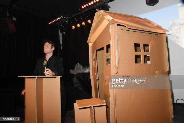 A performer with his cardboard house attends 'Le Temps Retrouve' Party at Les Bains on November 17 2017 in Paris France