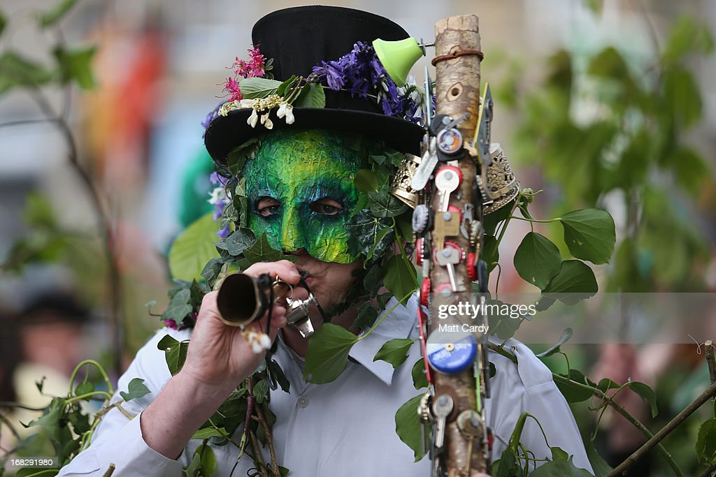 A performer with the Hal-an-Tow pageant blows his horn as part of the Helston Flora Day celebrations on May 8, 2013 in Cornwall, England. The annual Flora Dance, also known as the Furry Dance, is one of the UK's oldest customs still practised today and is said to be a celebration of the passing of Winter and the arrival of Spring. A series of dances take place throughout the day, beginning at 7am, all over the Cornish town and even in and out of private houses and shops. However the highlight is the midday dance which was traditionally the dance of the gentry in the town and is why men still wear top hats and tails while the women dance in their finest dresses.