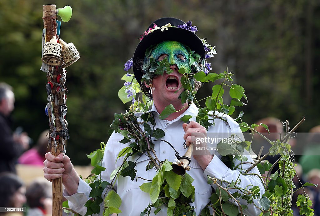 A performer with the Hal-an-Tow pageant takes part in a performance as part of the Helston Flora Day celebrations on May 8, 2013 in Cornwall, England. The annual Flora Dance, also known as the Furry Dance, is one of the UK's oldest customs still practised today and is said to be a celebration of the passing of Winter and the arrival of Spring. A series of dances take place throughout the day, beginning at 7am, all over the Cornish town and even in and out of private houses and shops. However the highlight is the midday dance which was traditionally the dance of the gentry in the town and is why men still wear top hats and tails while the women dance in their finest dresses.