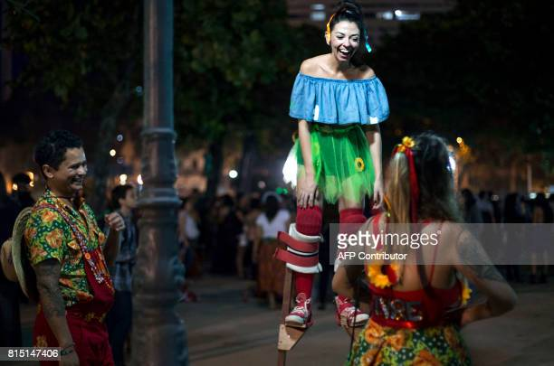 Performers and revellers take part in a Festa Junina party at Paris Square in Gloria neighborhood in of Rio de Janeiro Brazil on July 15 2017...