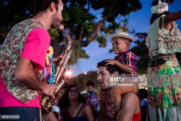 Performers and revellers take part in a Festa Junina party at Paris Square in Gloria neighborhood in Rio de Janeiro Brazil on July 15 2017 Annually...