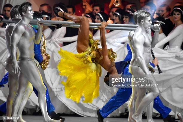 Performers are seen on stage during the Life Ball 2017 show at City Hall on June 10 2017 in Vienna Austria