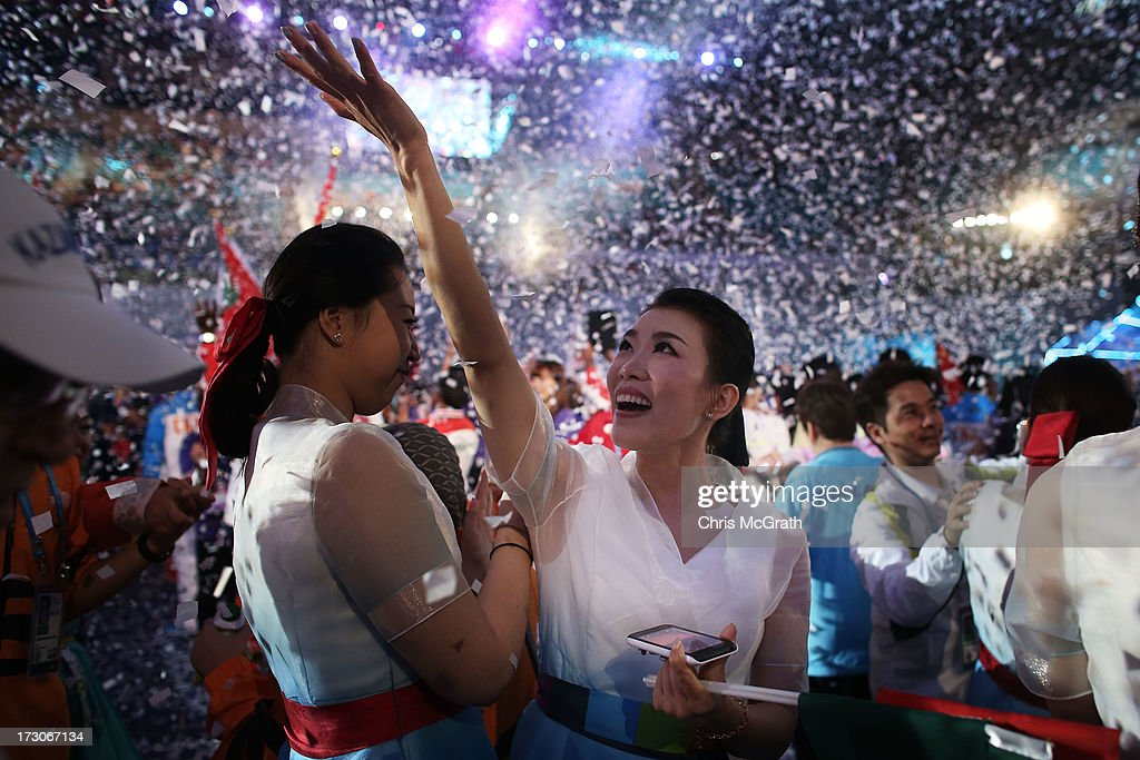 Performers, athletes and volunteers dance and celebrate at a concert during the closing ceremony of the 4th Asian Indoor & Martial Arts Games at Incheon Samsan World Gymansium on July 6, 2013 in Incheon, South Korea.
