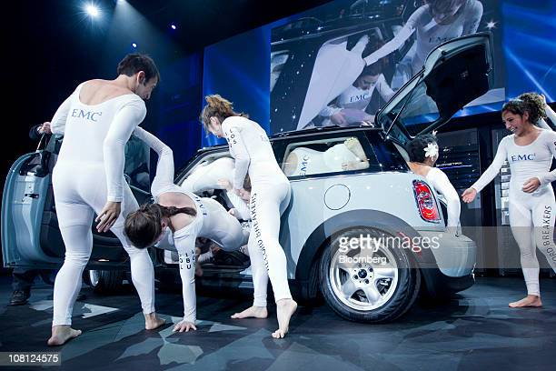 Performers attempt to fit more than twenty people in a Mini Cooper in order to break the Guinness World record at a media event in New York US on...