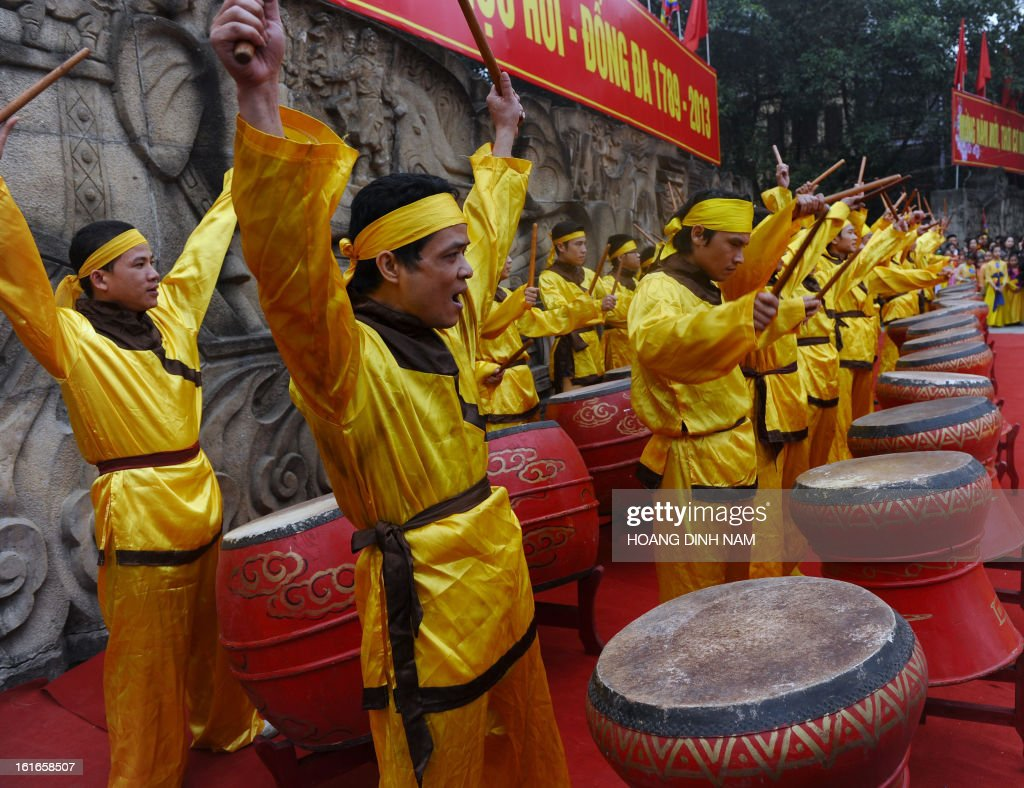 Performers beat drums during a ceremony to mark the 224th anniversary of Vietnam's Dong Da victory over Chinese invading troops in the spring of 1789 at the site of the historical battlefield in Hanoi on February 14, 2013. AFP PHOTO/HOANG DINH Nam