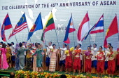 Performers carry flags of ASEAN member countries during a ceremony marking the 45th anniversary of the Association of Southeast Asian Nations and its...