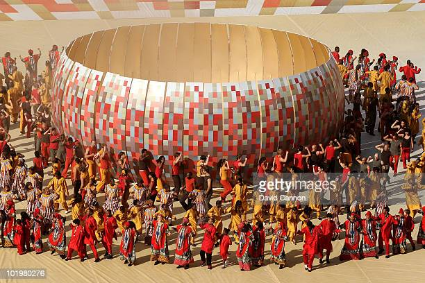 Performers dance around a representation of the calabash cooking pot which inspired the design of Soccer City Stadium during the Opening Ceremony...