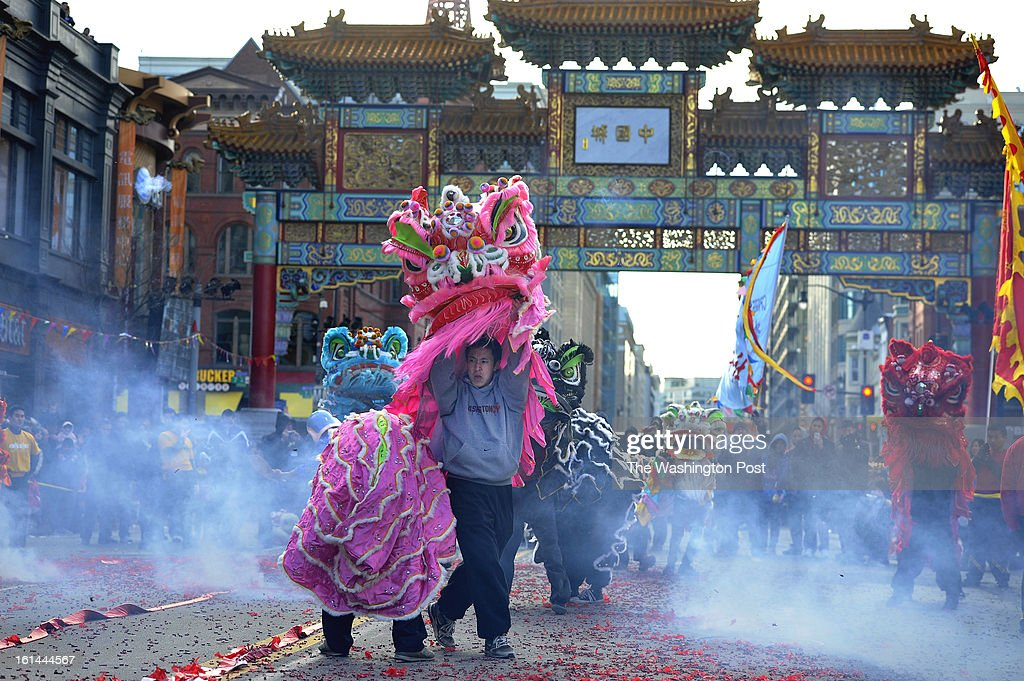 Performers dance around firecrackers during a celebration of the Chinese New Year on Sunday February 10, 2013 in Washington, DC. Scores of people turned out for the event that ushers in the year of the Snake.