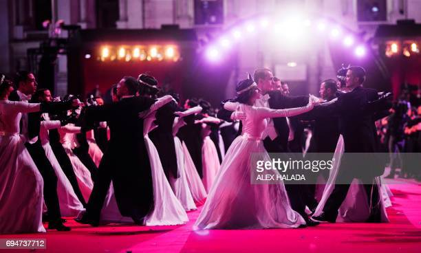 Performers dance during the 24th Lifeball in front of City Hall in Vienna Austria on June 10 2017 The Life Ball is the largest European charity event...