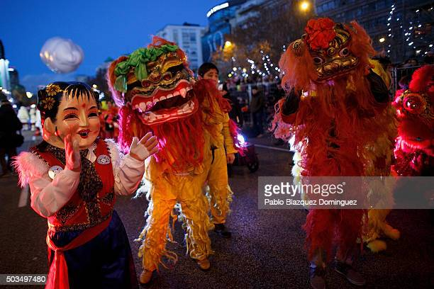 Performers dance during the 'Cabalgata de Reyes' or the Three Kings parade on January 5 2016 in Madrid Spain The traditional parade takes place...