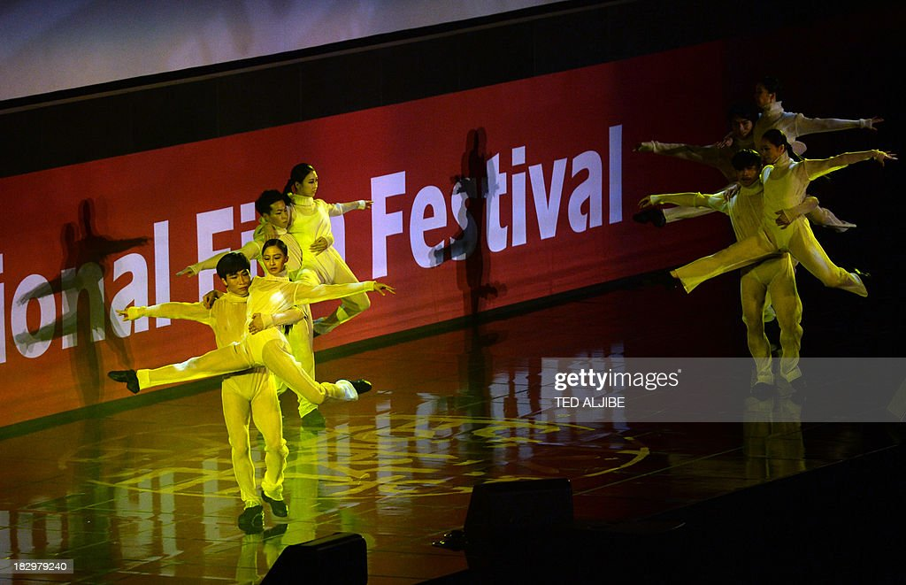 Performers dance during the opening ceremony of the 18th Busan International Film Festival (BIFF) in Busan on October 3, 2013. Stars of Asian cinema gathered in the South Korean port city of Busan October 3, for the opening of the region's biggest film festival, showcasing new talent in a region where box office takings will soon outstrip North America. AFP PHOTO/TED ALJIBE